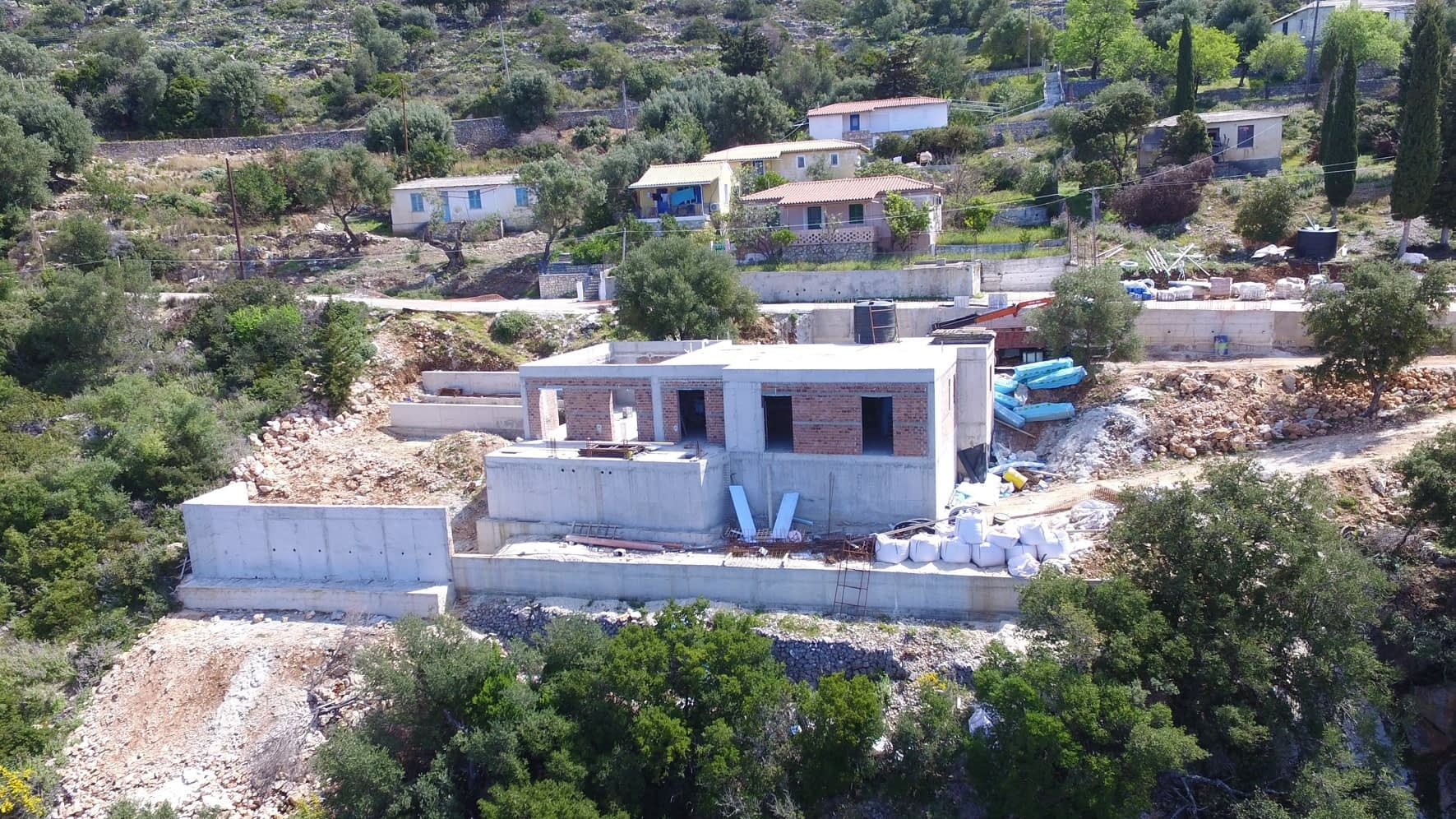 Aerial view of house in construction stage for sale in ithaca Greece, Lefki