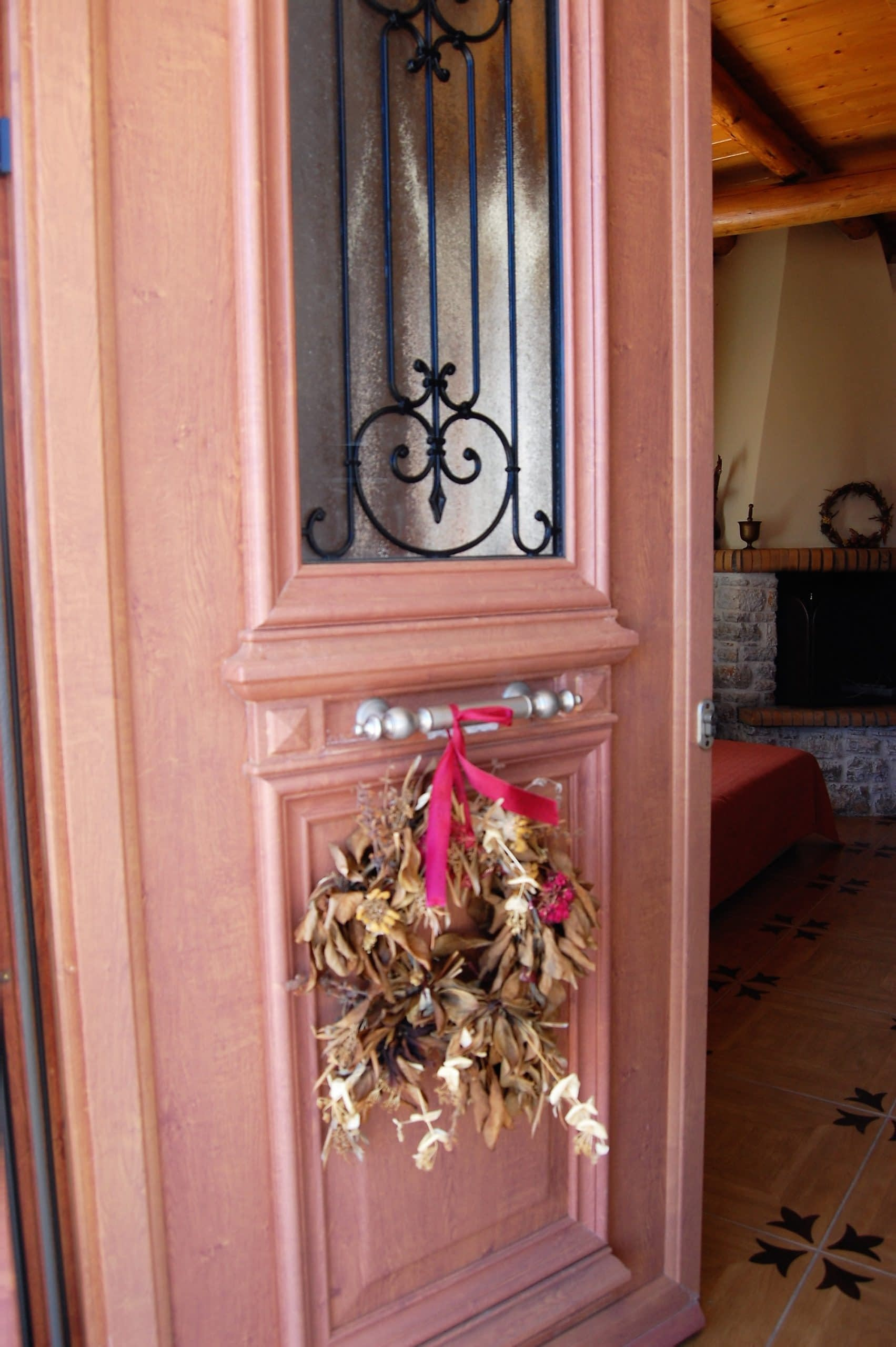 Decorative front door of stone house for rent Ithaca Greece