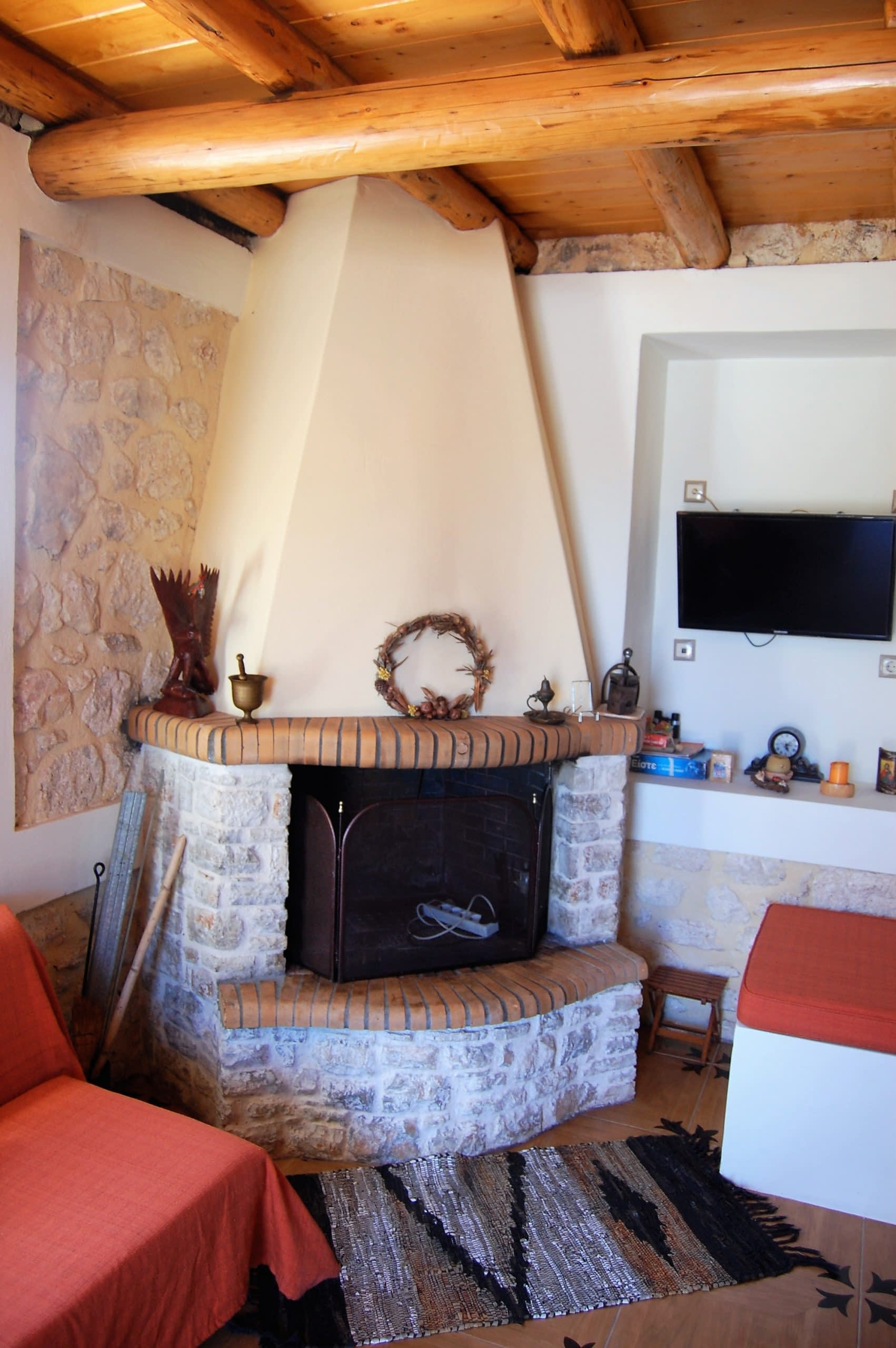 Fireplace of stone house for rent Ithaca Greece