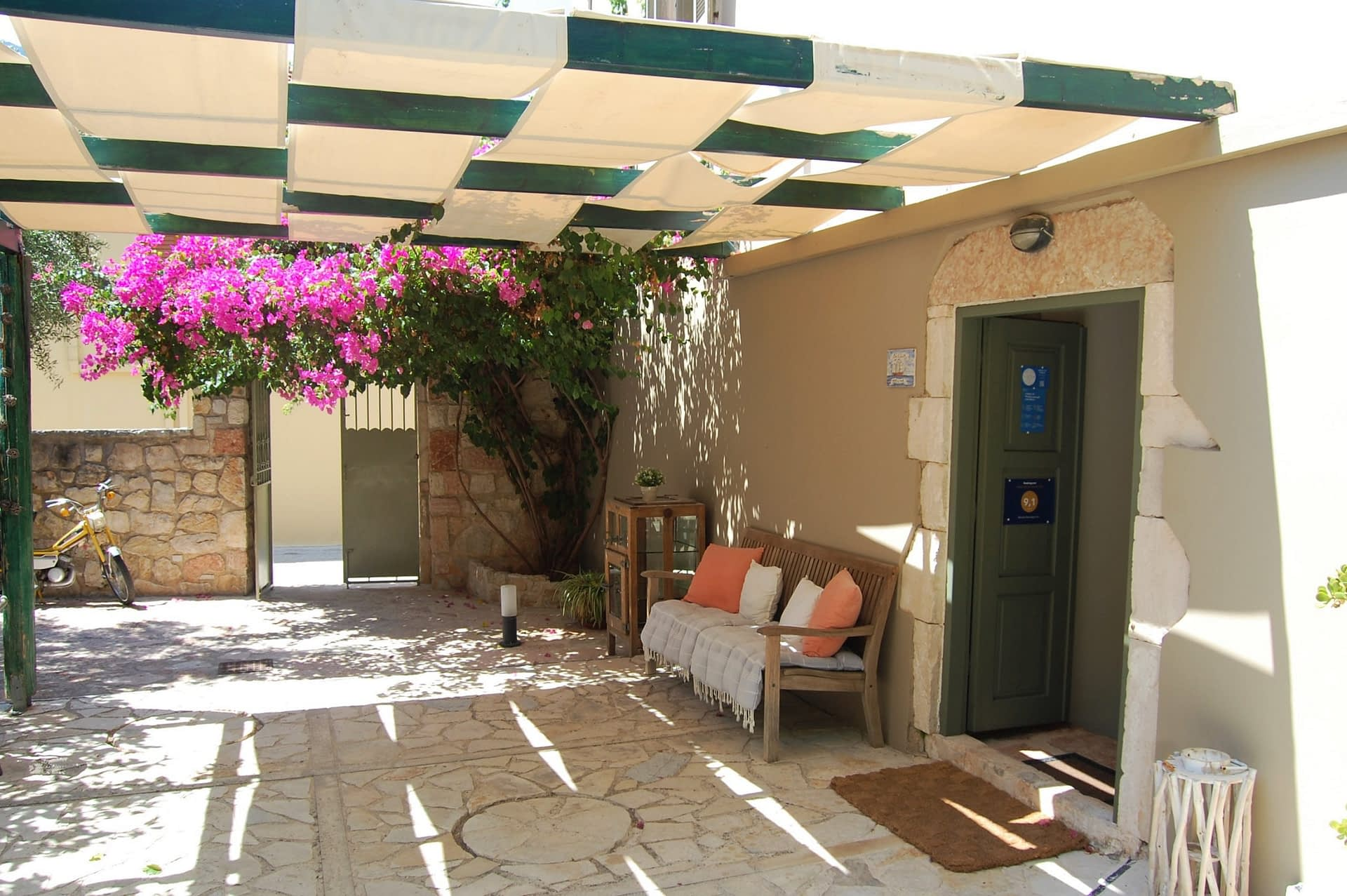 Outdoor terrace area of boutique hotel for sale on Ithaca Greece Vathi