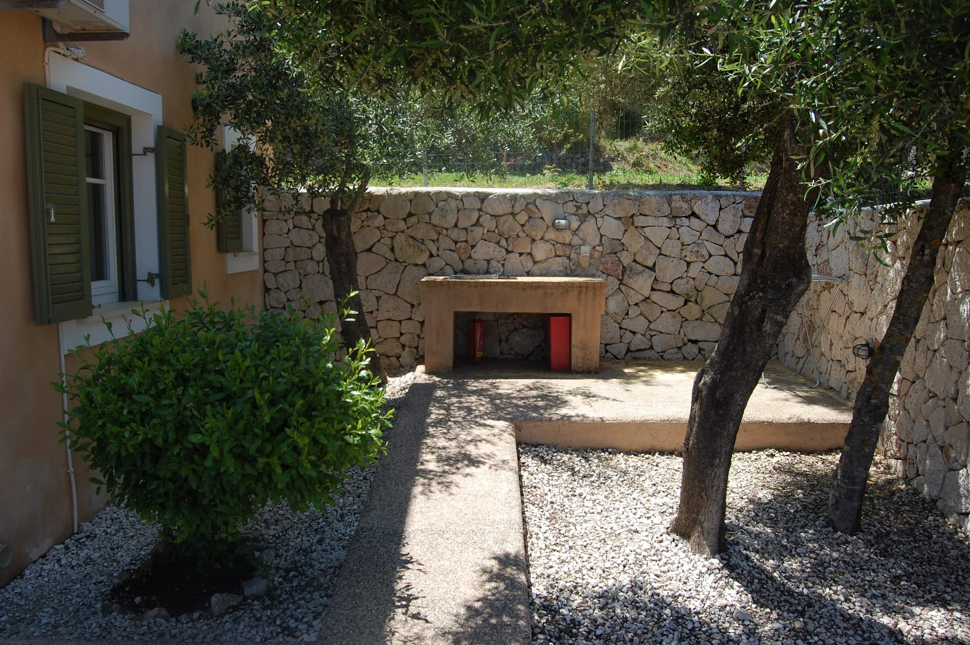 Exterior courtyard of Homer's View houses to rent MV Properties Ithaca Greece