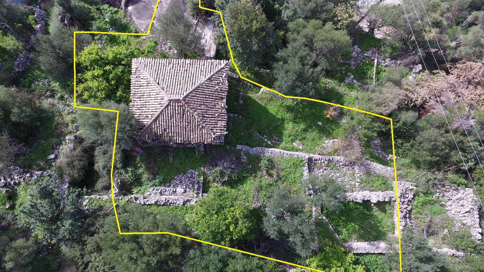 Aerial view with border of house with ruin for sale in Ithaca Greece Lefki