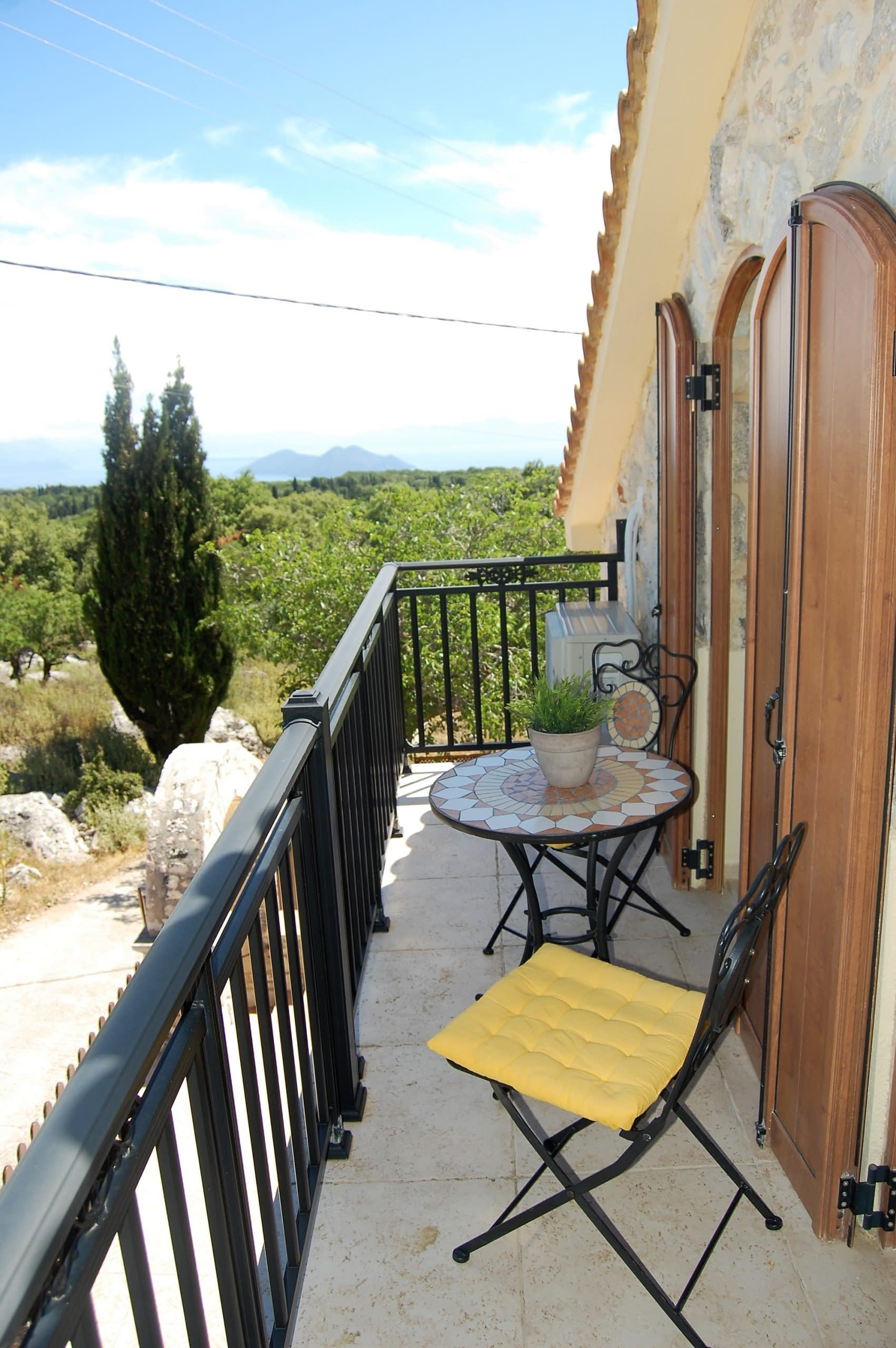 Top level balcony overlooking landscape of stone house for rent Ithaca Greece