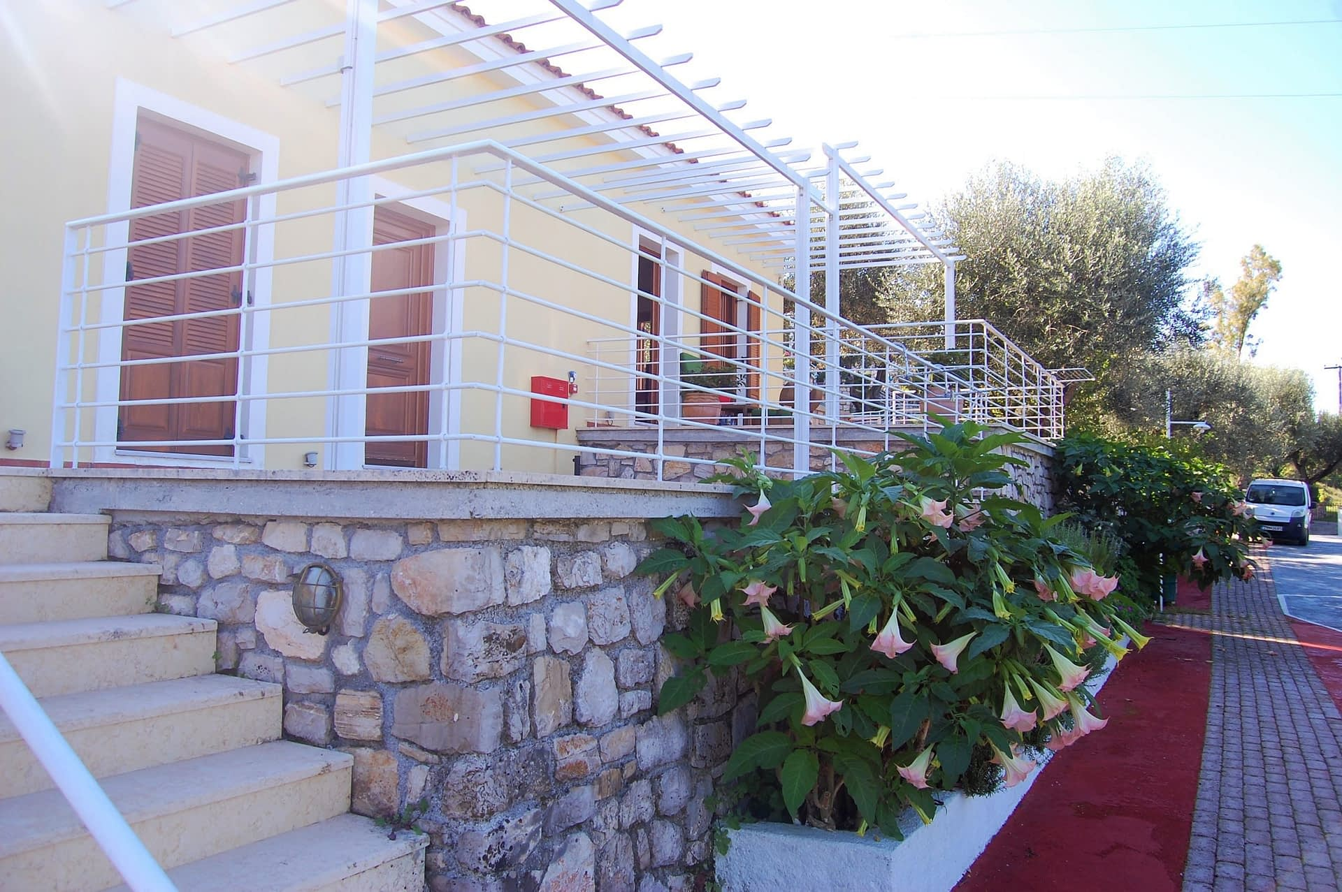 Exterior facade and garden of holiday house for rent in Ithaca Greece, Frikes