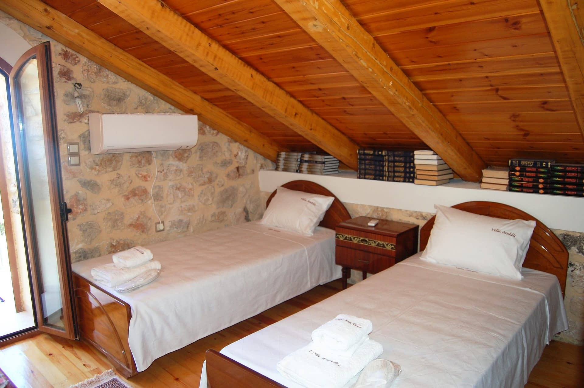 Twin bedroom of stone house for rent Ithaca Greece