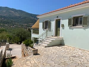 Exterior facade with stone terrace of house for sale in Ithaca Greece, Vathi