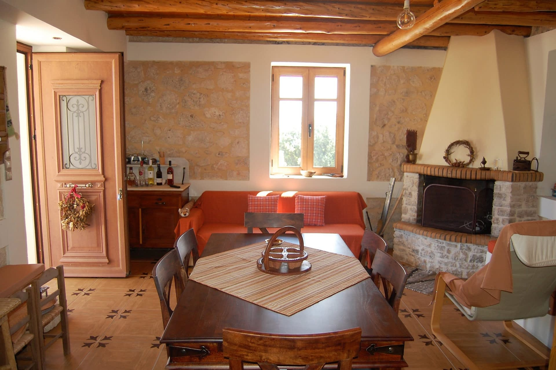 Open plan lounge of stone house for rent Ithaca Greece