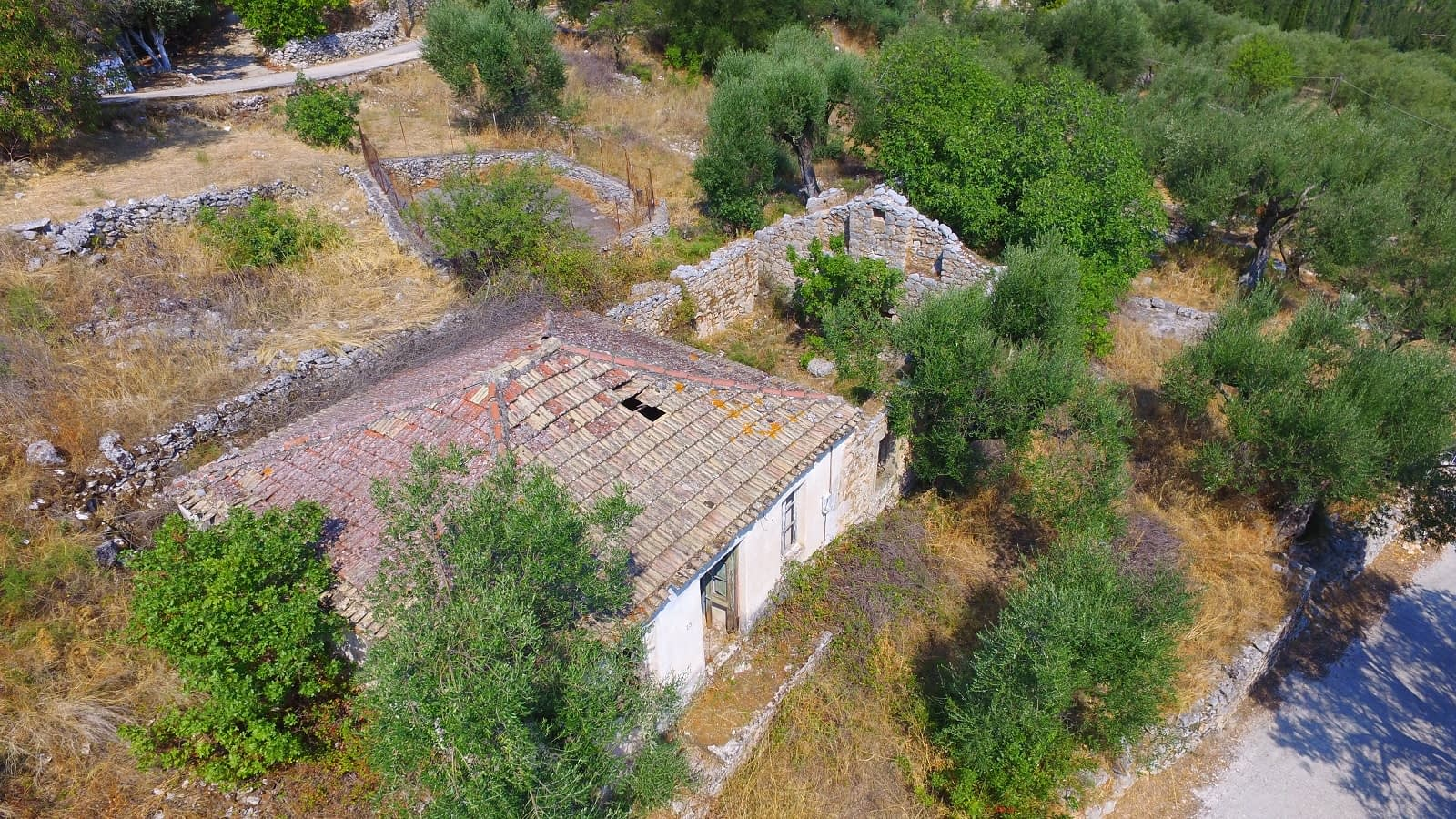 Aerial view of house and ruins for sale in Ithaca Greece Perachori