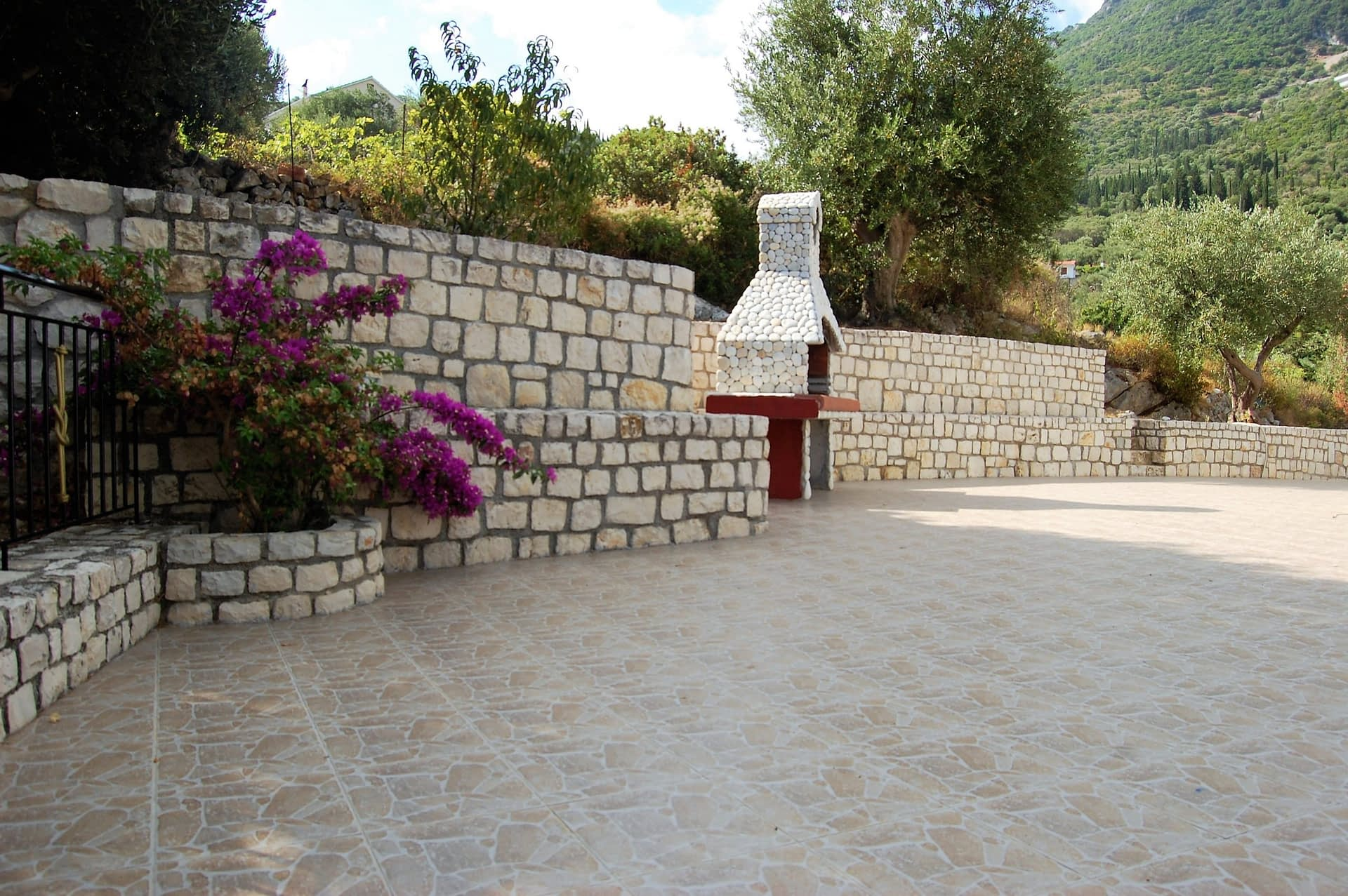 Outside patio area and barbecue of property for sale in Ithaca Greece Vathi