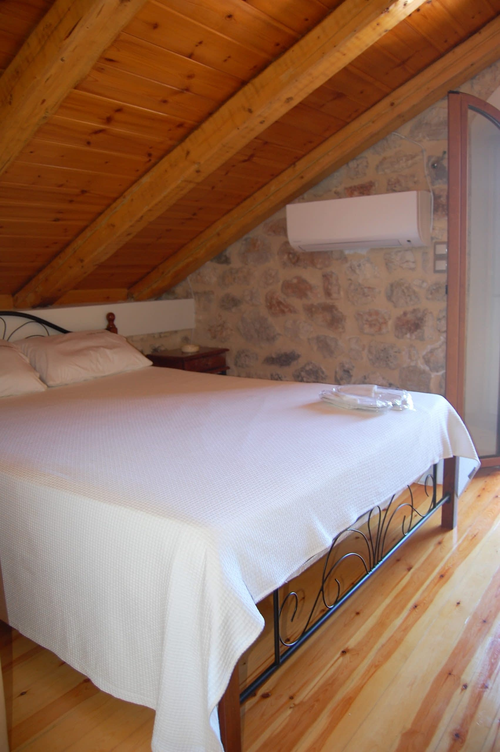 Double bedroom of stone house for rent Ithaca Greece