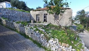 Exterior facade and garden of house for sale in Ithaca Greece Kolleri