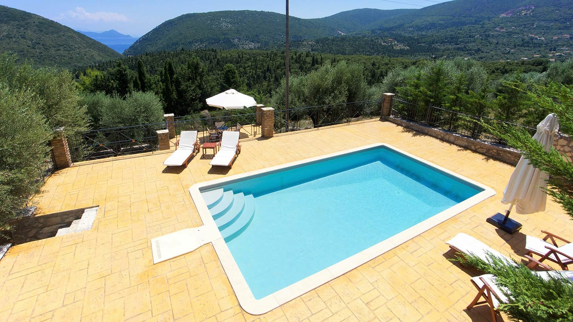 Courtyard and swimming pool of stone villa for rent in Ithaca Greece, Pilikata