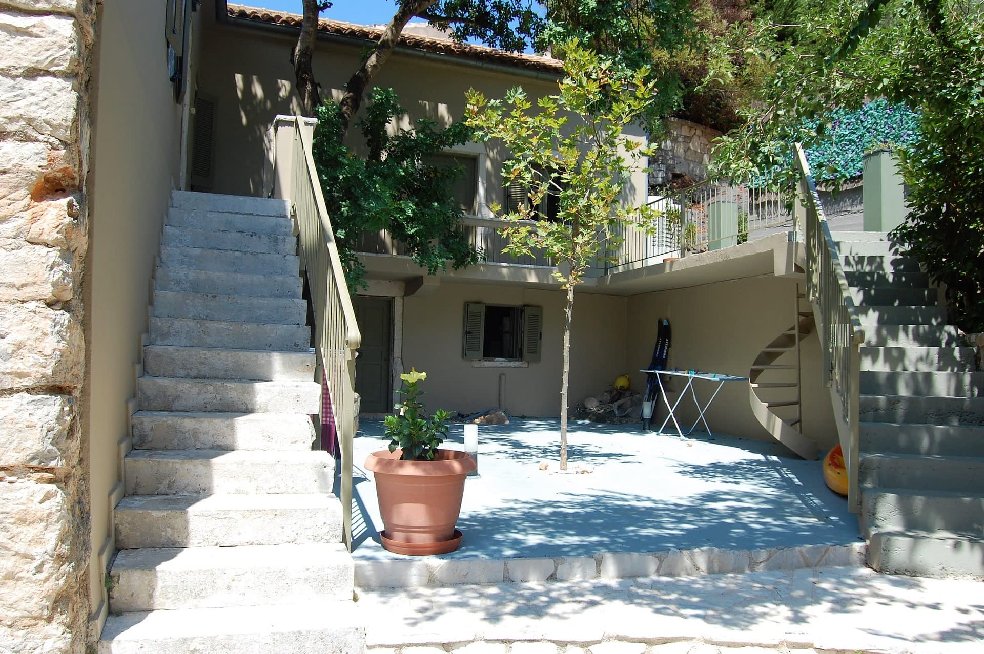Outdoor multi level terrace area of boutique hotel for sale on Ithaca Greece Vathi
