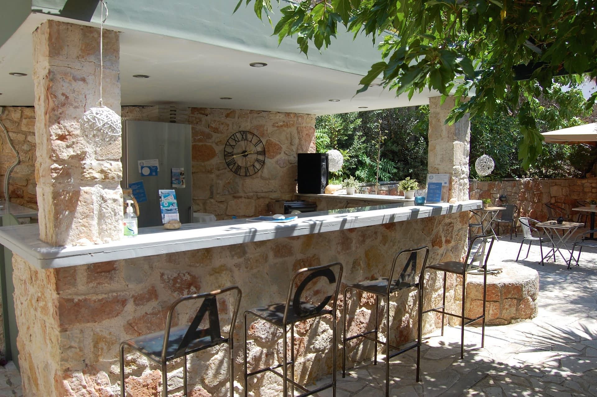 Outdoor entertainment area of boutique hotel for sale on Ithaca Greece Vathi