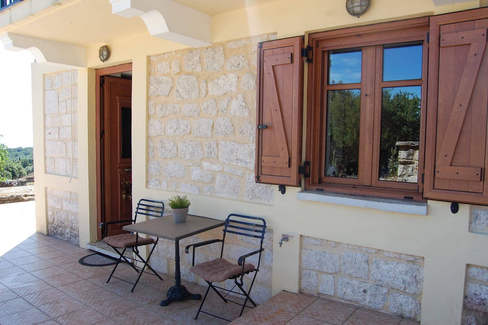 Outdoor patio of stone house for rent Ithaca Greece